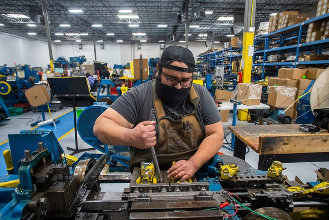 Daniel Chavira, a setup technician works at the Keats Southwest manufacturing plant in El Paso, Texas.