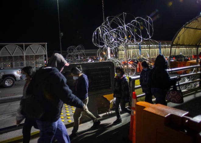Children and their mother enter Mexico from El Paso, Texas.