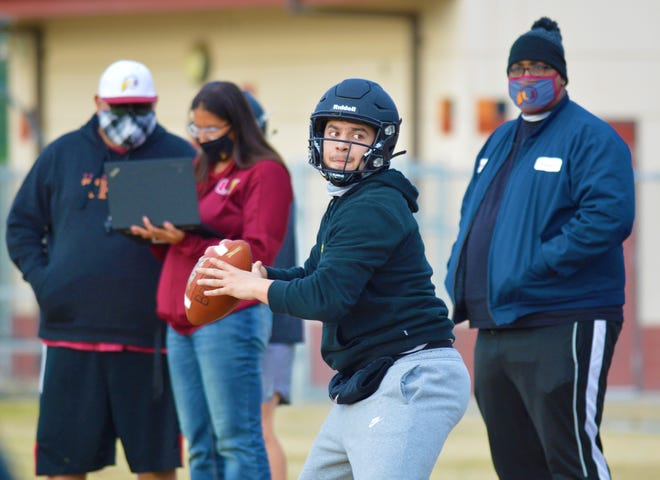 The Tulare Union High School football team practices on March 11, 2021 in Tulare.