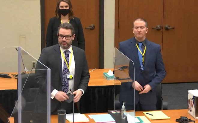 In this image taken from video, defense attorney Eric Nelson, left, and defendant former Minneapolis police officer Derek Chauvin, right, and Nelson's assistant Amy Voss, back, introduce themselves to potential jurors as Hennepin County Judge PeterCahill presides, prior to continuing jury selection, Monday, March 15, 2021, in the trial of Chauvin, at the Hennepin County Courthouse in Minneapolis, Minn. Chauvin is charged in the May 25, 2020, death of George Floyd.