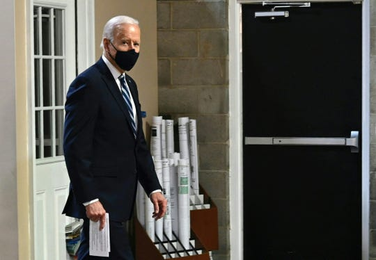 US President Joe Biden visits Smith Flooring, a small minority-owned business, to promote his American Rescue Plan in Chester, Pennsylvania, on March 16, 2021.