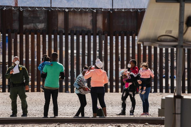 Border Patrol agents apprehend a group of migrants near downtown El Paso, Texas, following the congressional border delegation visit on March 15, 2021.
