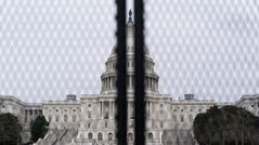An inner perimeter anti-scaling fence is around the U.S. Capitol, Tuesday, March 16, 2021, in Washington. (AP Photo/Alex Brandon) ORG XMIT: DCAB121