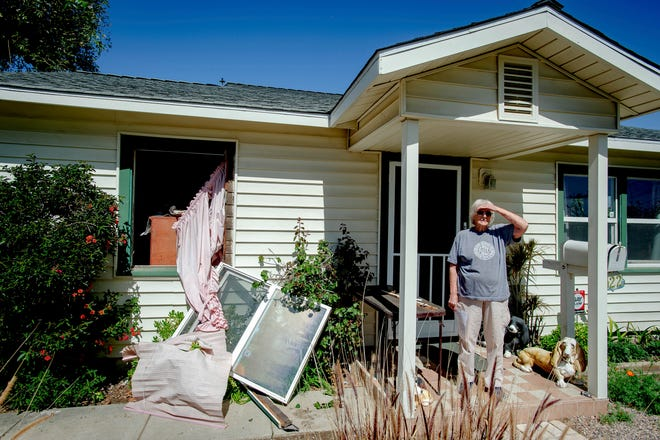 Van Vant stands in front of her home damaged home after a nearby fireworks stash exploded in Ontario, Calif., Tuesday, March 16, 2021. (Watchara Phomicinda/The Orange County Register via AP) ORG XMIT: CAANR302