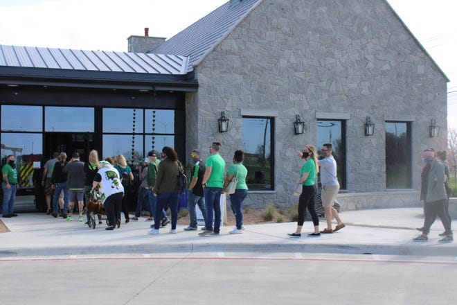 Guests line up at the door for the grand opening of Cork & Barrel Craft Kitchen + Microbrewery in Round Rock on Wednesday.