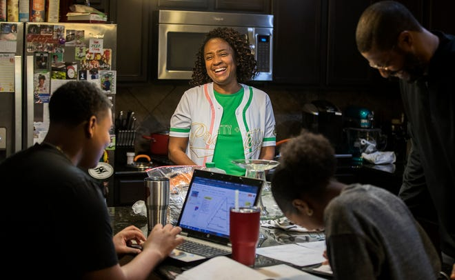 Danielle Austin jokes with her family as she prepares dinner after Bible study at their home in Pflugerville in February. Census data show that many African Americans who once lived in East and Southeast Austin have chosen to move out of the city as they seek better school districts and quieter places to raise a family.