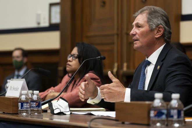 Christopher Swecker, right, chairman of the Fort Hood Independent Review Committee is accompanied by fellow committee member Carrie Ricci, at a congressional hearing about reforming criminal investigations at Fort Hood on Tuesday.