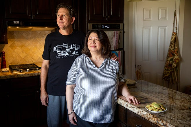 Mike and Christine Cramer stand for a portrait in their home March 17 in West Austin. The couple, who have been together for 35 years, used the past year of the pandemic to cook together at home more than they ever had. They started a spreadsheet to track dishes they've made.