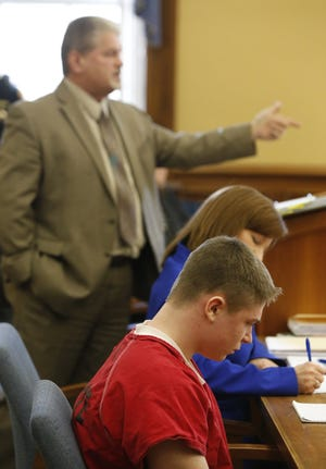 Medina County Prosecutor S. Forrest Thompson (standing) argues for a prison sentence of life without parole for Gavon Ramsay, 17, (front) in Medina County Common Pleas Court in January 2019.