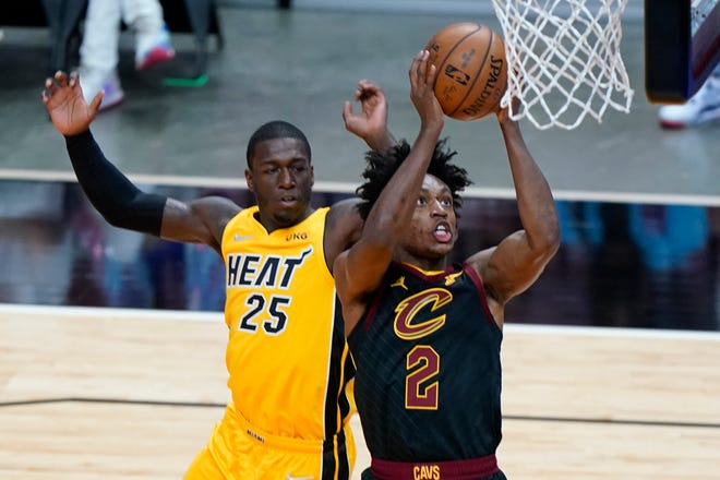 Cavaliers guard Collin Sexton (2) goes up for two of his 21 points in the Cavs' 113-98 loss to the Miami Heat on Monday night. [Wilfredo Lee/Associated Press]