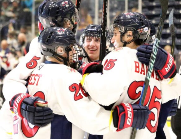 Several Amarillo Bulls players gather around forward Brenden West (left, center) following West's second period goal during the 2019 NAHL South Division matchup against the Topeka Pilots at the Amarillo Cal Farley Coliseum Civic Center Complex.