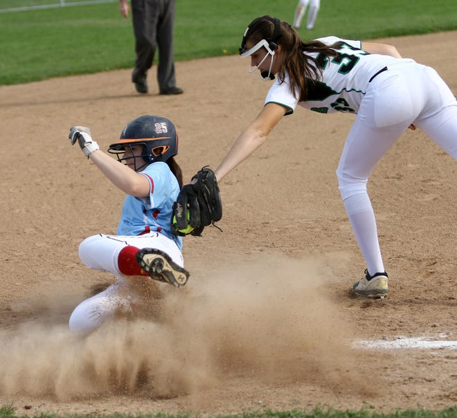 Alyssa White of Alliance slides into third base safely ahead of a tag during a 2019 game against West Branch. White will play softball at Mount Union.