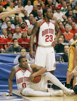 (NCL BIGTEN LAURON 12MAR06) Ohio State's J.J. Sullinger, 0, and teammate Je'Kel Foster, 23, react after Sullinger lost the ball out of bounds in the final minutes of the second half of their Big Ten championship game at Conseco Fieldhouse, March 12, 2005. (Dispatch photo by Neal C. Lauron)