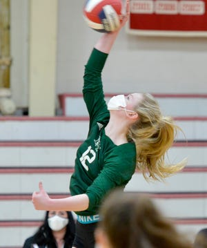 "D-Y's Grace Presswood (19 kills,  27 blocks) hits a return against Barnstable at Tuesday night's high school girls volleyball match in Hyannis. ""To beat Barnstable is always our goal,"" she said. ""Every day we've put our all into it. We've lost every year to them, and we didn't want to have that reputation anymore."""