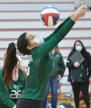 Dennis-Yarmouth setter Luiza Silva, seen here earlier this season, recorded her 1,000th career assist Thursday as the Dolphins swept Nauset in South Yarmouth and wrapped up an undefeated girls volleyball regular season.