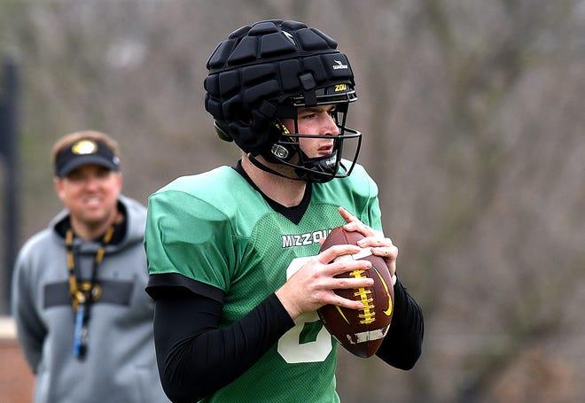 Missouri head football coach Eli Drinkwitz watches as quarterback Connor Bazelak (8) throws during practice March 16 at the Kadlec Practice Fields.
