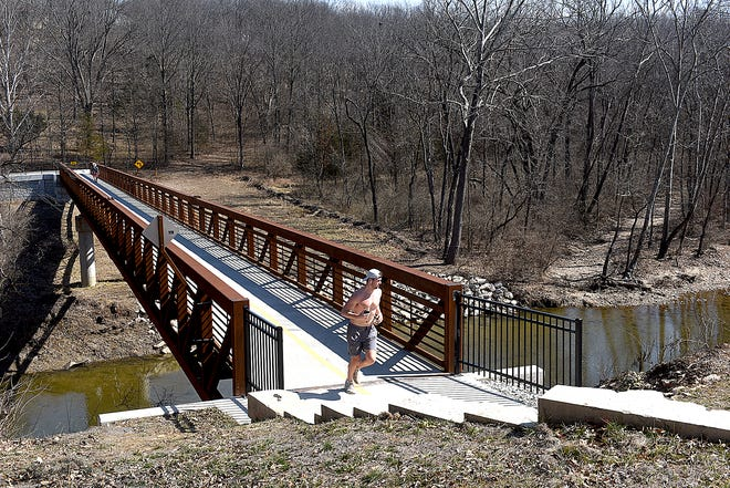 A jogger travels the Shepard to Rollins Trail on March 9.