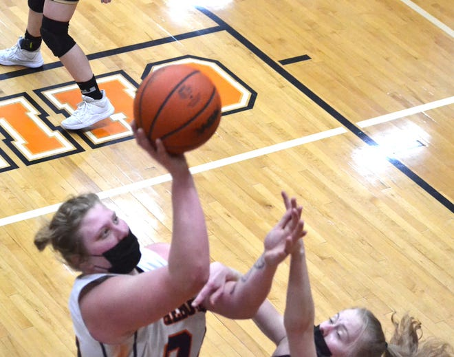 Cheboygan senior center Isabelle Buhr (left) puts up a shot against St. Ignace during the first half of a varsity girls basketball matchup in Cheboygan on Tuesday.