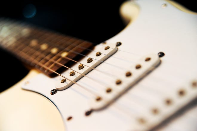 Local musician Dave Buker's guitar photographed after a performance at Rumba Cafe.