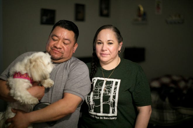 Edith Espinal with her husband, Manuel Gonzalez, and dog, Bella, at her West-Side home on March 16, about a month after Espinal returned from more than three years living in sanctuary at a Clintonville church.