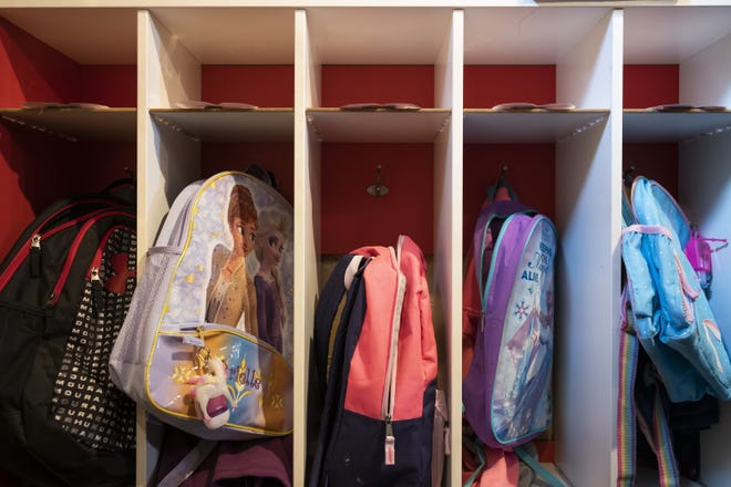 Kids' backpacks sit in their cubbies Tuesday at Nikki's Family Childcare and Preschool in Gnadenhutten.