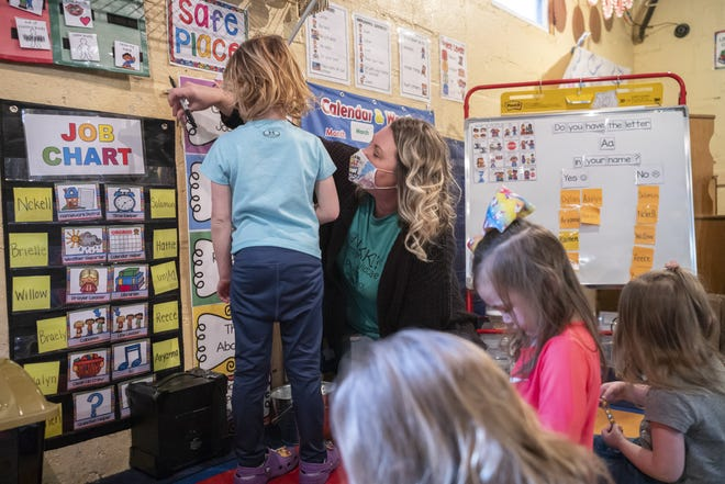 Nikki Wells hands out treats for kids who had good days on Tuesday, Mar. 16, 2021 at Nikki's Family Childcare and Preschool in Gnadenhutten, Ohio. A child tax credit in the American Rescue Act has the potential to greatly impact children and childcare providers in rural areas.