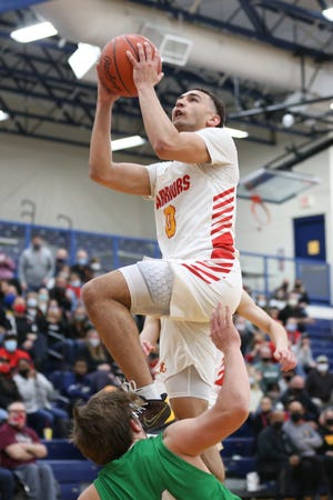 With a tall lineup that includes 6-foot-3 point guard D.J. Moore, here rising to take a shot in a regional final win over Proctorville Fairland, Worthington Christian has morphed from a perimeter team to one that relies on its size and length.