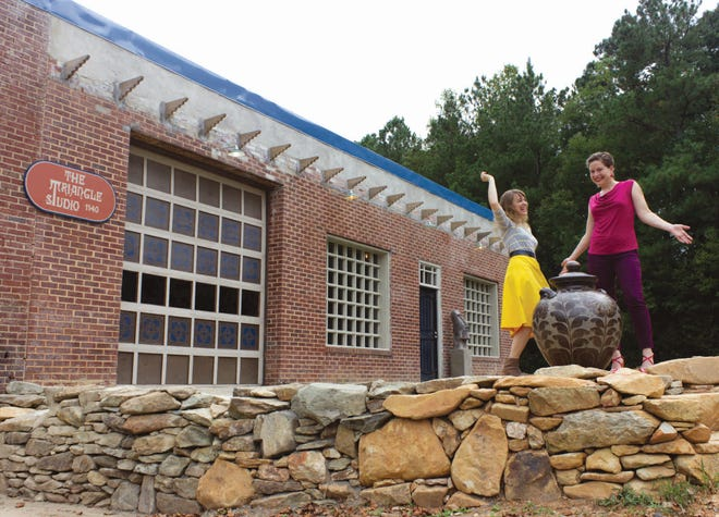Kate Waltman (left) and business partner Erin Younge are two of five Randolph County artists to receive  Artists Support Grants from ArtsGreensboro and The Arts Council of Winston-Salem andForsyth County to improve two separate art studios in Seagrove. In the photo, they are pictured outside one of the studios - The Triangle Studio - in which they are partners.