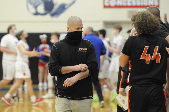 Hudson head coach Lance Horwath looks to his bench during a timeout in Tuesday's game at Leanwee Christian.