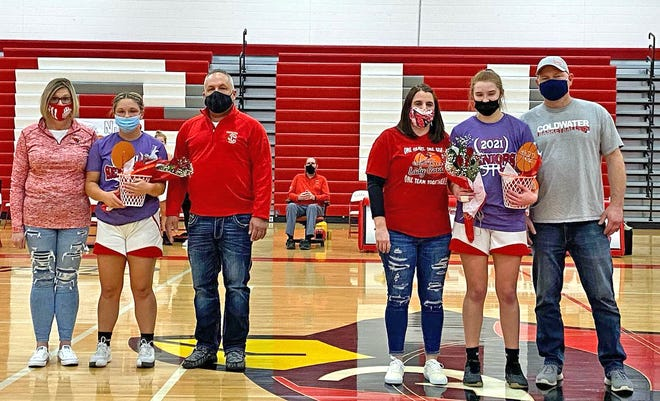 The Coldwater Lady Cardinals celebrated Senior Night Tuesday, honoring their two seniors Mia Rzepka (left) and Abby Herman (right). Coldwater fell to Pennfield in an I-8 contest.