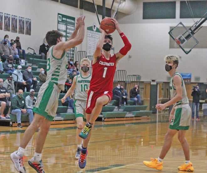 Coldwater's Ethan Crabtree (1) shoots for two versus Pennfield Tuesday