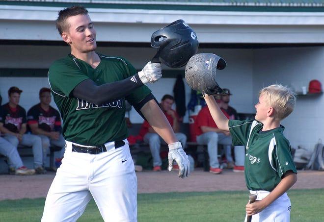 University of Delaware baseball player Joseph Carpenter taps helmets with the Mohawk Valley DiamondDawgs' bat boy after hitting a home run July 13, 2019, against the Glens Falls Dragons at Veterans Memorial Park.
