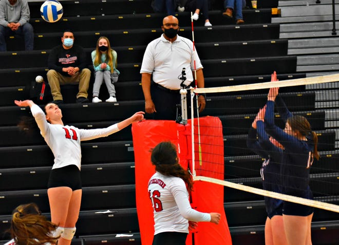 Southeastern Community College's Salena Sayre leaps to spike the volleyball against Southwestern Tuesday night at Loren Walker Arena. Kalyse Whitehead (16) watches. Sayre finished with a team-high 19 kills in the Blackhawks' 3-1 victory.