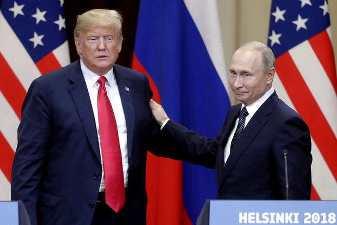 Then-President Donald Trump, left, and Russian President Vladimir Putin give a joint news conference following their meeting at the Presidential Palace in Helsinki, Finland, on July 16, 2018.
