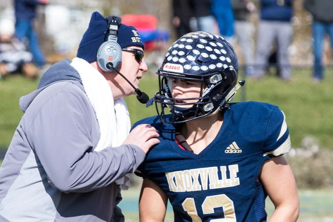 Knoxville High School football coach Ryan Hebard gives instructions to quarterback Bryar Fleisher during a Class 2A first round playoff game against Rockford Christian on Saturday, Nov. 2, 2019 at Dennis Larson Field.