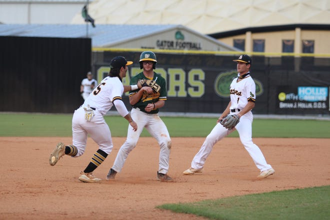 St. Amant third-baseman Lee Amedee tags out a Walker base-runner during the Gators' 7-5 loss on Tuesday night.