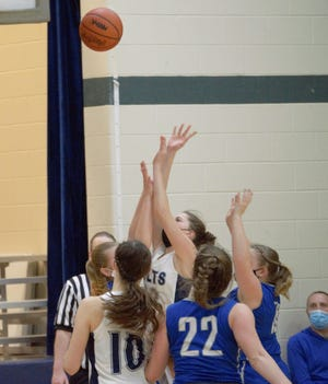 The Hillsdale Academy Colts Girls Basketball team fights for a rebound earlier this year.