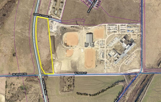 The city of Sherman is looking to sell 15 acres of land adjacent to the new Sherman High School site.