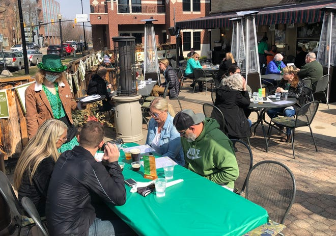 The Curragh Irish Pub celebrated St. Patrick's Day, Wednesday, March 17, with customers enjoying the sunny skies and mild temperatures. Gov. Whitmer's state dining restrictions closed the pub for last year's St. Patrick's Day.