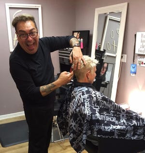 Benito Barron poses for a photo in his salon. Barron has owned SoHo Salon in Holland for over 17 years.