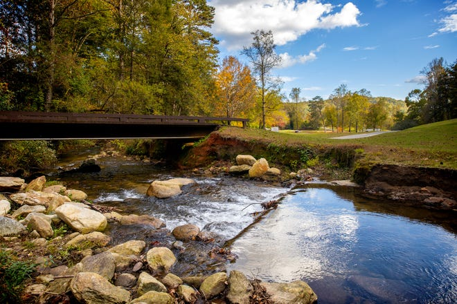 A river winds through the golf course at Bald Mountain at Rumbling Bald.