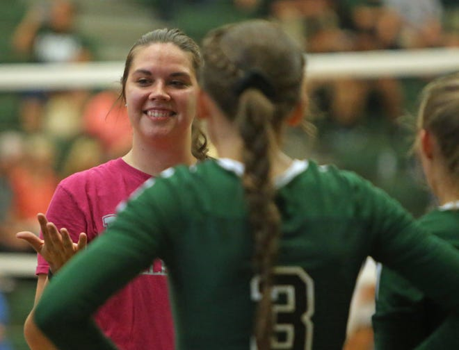 East Henderson volleyball coach Lauren Ashe talks with her players during a timeout in their game against Polk County during the 2018 season at East. [DEAN HENSLEY/ TIMES-NEWS]