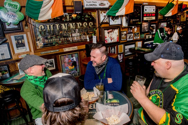 St. Patrick's Day revelers Donnie Driscoll, left, of West Peoria, Edward Watkins, middle of East Peoria, John Matheny, right, of West Peoria and Riley Driscoll, foreground, also of West Peoria, enjoy a pint or two Wednesday, March 17, 2021 at Jimmy's Bar, 2801 W. Farmington Rd., in West Peoria.