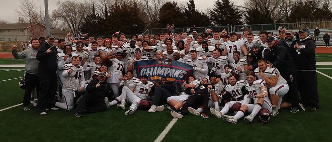 The Bethel College football team celebrates winning the KCAC championship Saturday at Tabor.