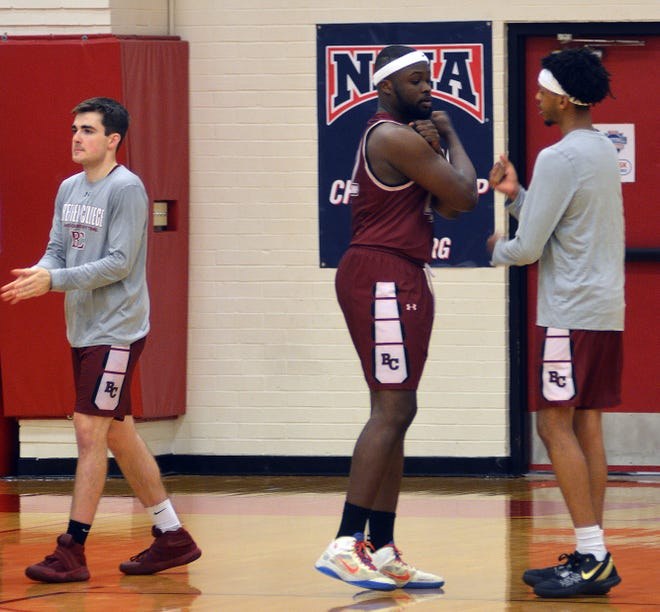 The Bethel College men's basketball team goes through opening introductions during second-round play at the NAIA national.