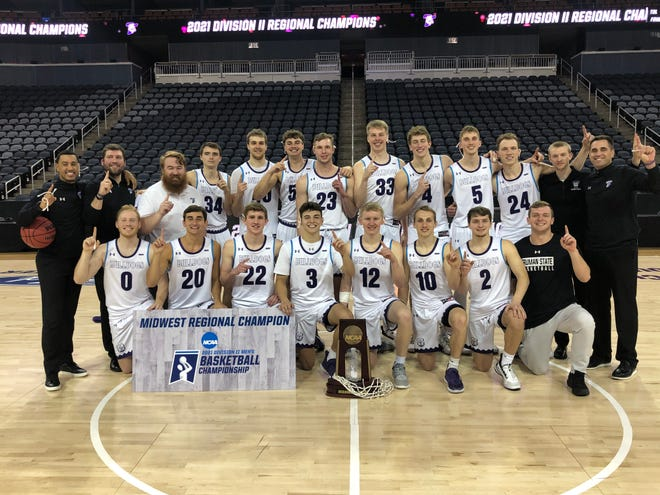 The Truman men's basketball team poses with its regional championship after defeating Michigan Tech on Tuesday night, punching its ticket to the Elite Eight.