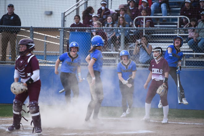 Frenship's Makayla Garcia slides into home for a three-run inside the park homer during the softball game against Midland Lee on Tuesday March 16, 2021 at Tiger Field in Wolfforth, Texas.