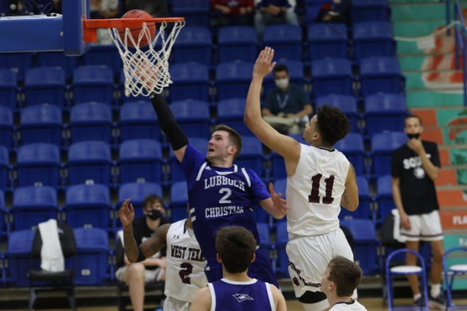 LCU forward Parker Hicks (2) goes past West Texas A&M forward Kavon Booker for two of his 27 points during the South Central Regional final of the Division II NCAA Tournament. The Buffaloes beat the Chaparrals 101-92 to advance to the Elite Eight.