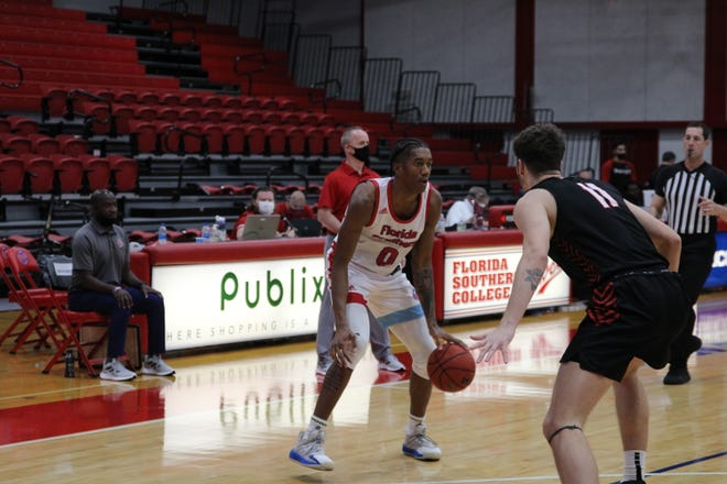 Florida Southern's Jalyn Hinton works against the Rollins defense on Tuesday night in Lakeland. Hinton scored a game-high 33 points to lead the Mocs to an 88-82 win and into the Sunshine State Conference Tournament semifinals on Thursday.