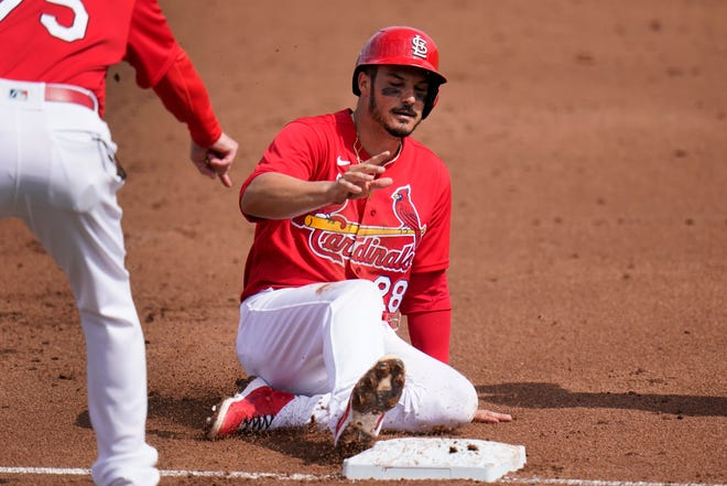 St. Louis Cardinals' Nolan Arenado slides safely into third after advancing on a throwing error by New York Mets catcher Tomas Nido during the first inning of a spring training baseball game Wednesday, March 3, 2021, in Jupiter, Fla.